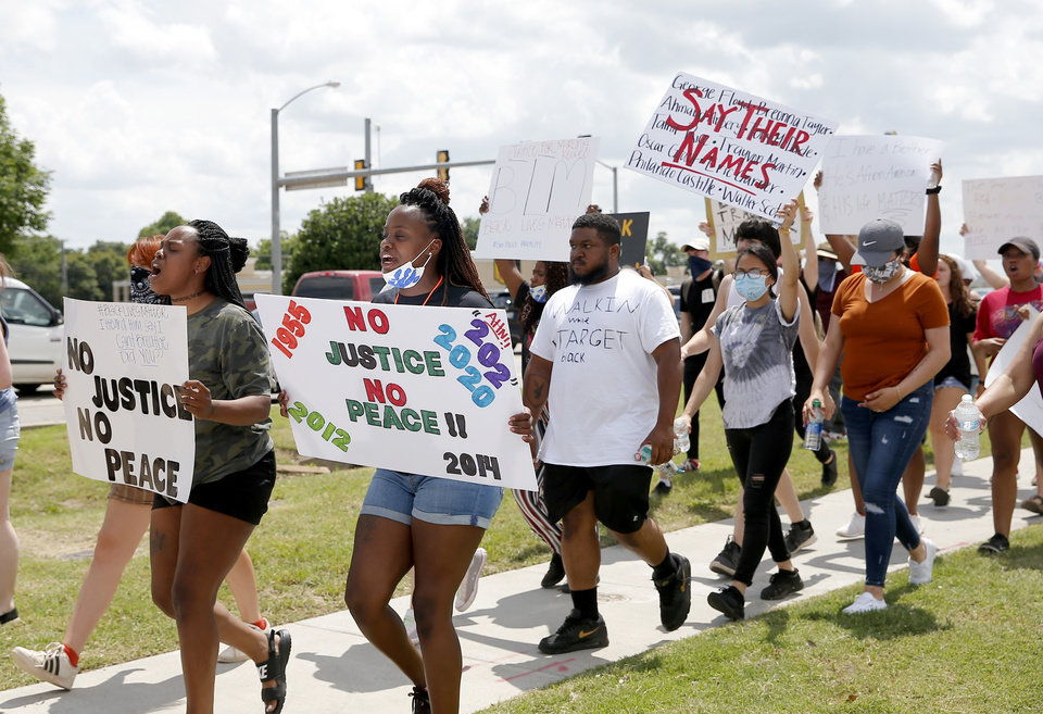 Photo - Protesters march to the Norman Police Department in Norman, Okla.  Tuesday, June 2, 2020.  [Sarah Phipps/The Oklahoman]