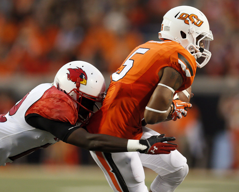 Photo - Oklahoma State's Josh Stewart (5) makes a catch in the second quarter during a college football game between the Oklahoma State University Cowboys (OSU) and the Lamar University Cardinals at Boone Pickens Stadium in Stillwater, Okla., Saturday, Sept. 14, 2013. Photo by Nate Billings, The Oklahoman