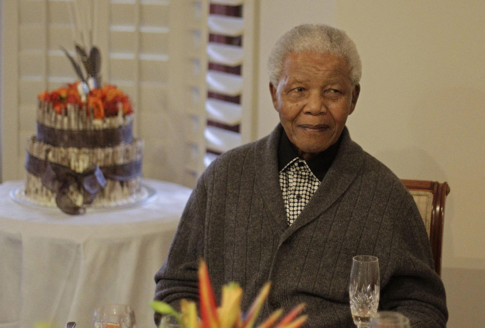 Photo - FILE - In this Wednesday, July 18, 2012 file photo, former South African President Nelson Mandela as he celebrates his 94th birthday with family in Qunu, South Africa.  A South African official says Mandela is breathing
