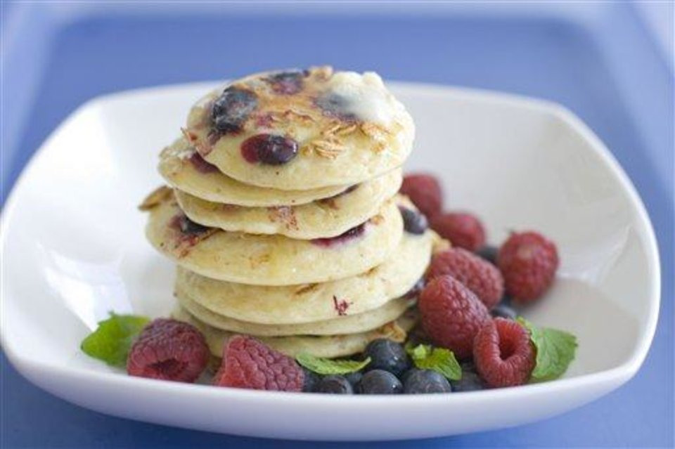 Photo - In this image taken on March 26, 2012, a plate of pancakes with blueberries and granola mixed in the batter is displayed in Concord, N.H.  (AP Photo/Matthew Mead)
