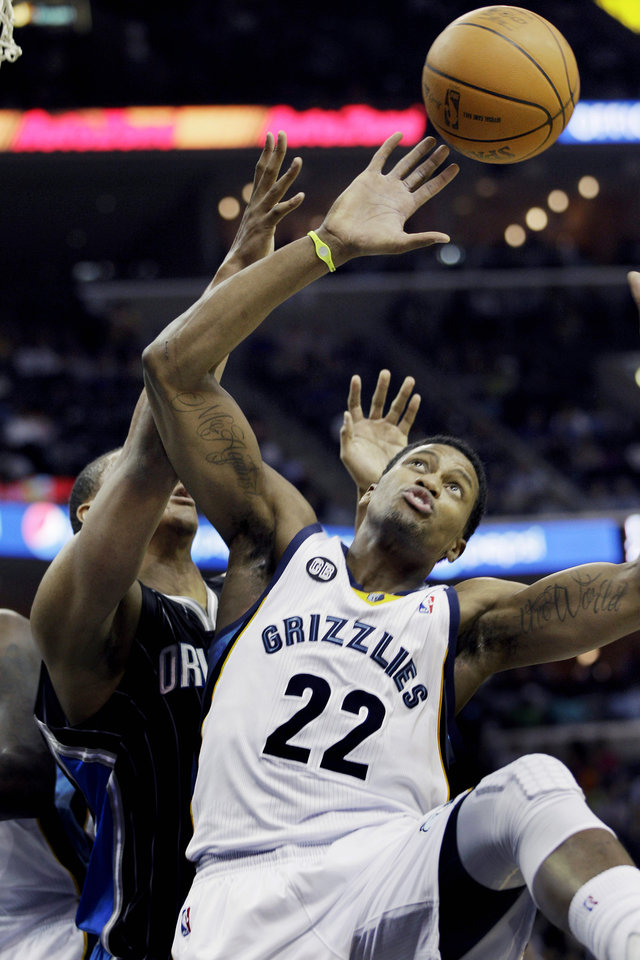 Memphis Grizzlies' Rudy Gay (22) goes for a rebound in front of Orlando Magic's Daniel Orton during the first half of an NBA basketball game in Memphis, Tenn., Thursday, April 26, 2012. (AP Photo/Danny Johnston)