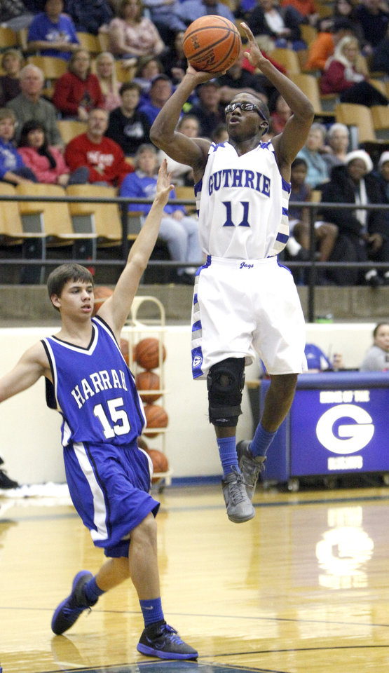 Guthrie\'s JT McFadden shoots over Harrah\'s J.J Jaworski during the high school basketball game between Guthrie and Harrah at Guthrie, Okla.., Tuesday, Dec. 20, 2011. Photo by Sarah Phipps, The Oklahoman