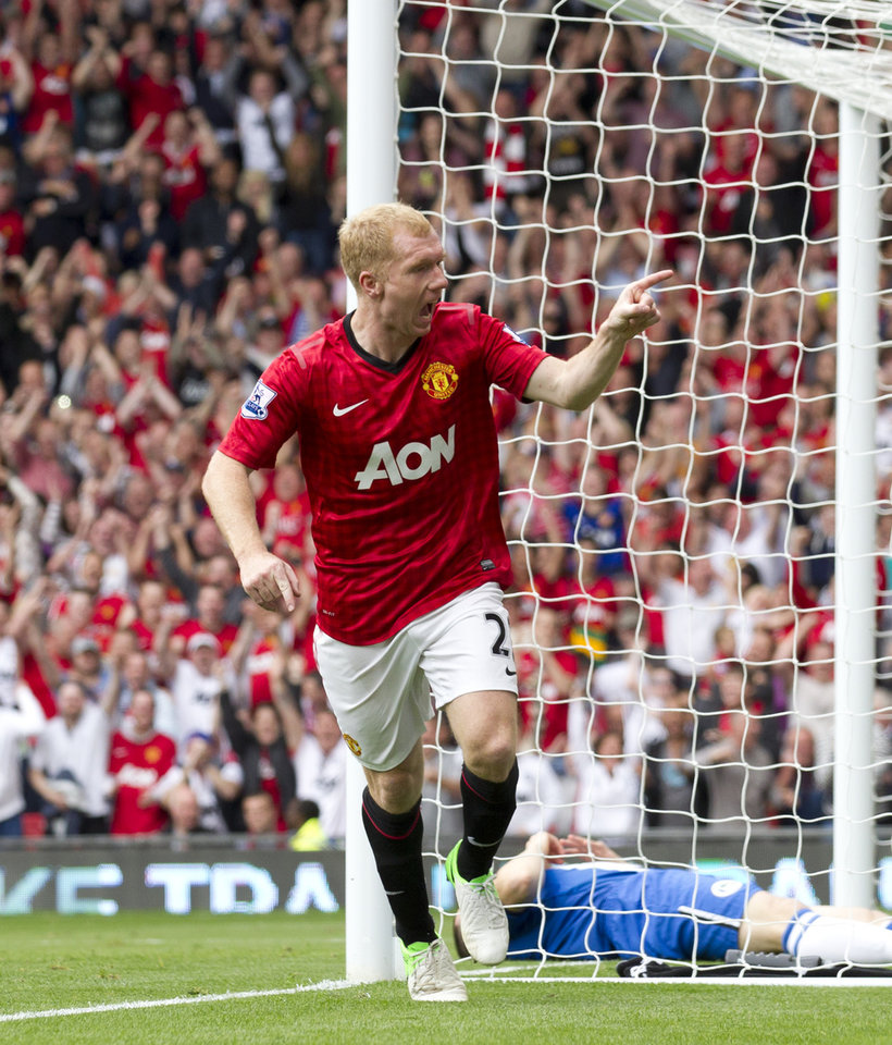 Photo -   Manchester United's Paul Scholes celebrates after scoring against Wigan Athletic during their English Premier League soccer match at Old Trafford Stadium, Manchester, England, Saturday, Sept. 15, 2012. (AP Photo/Jon Super)