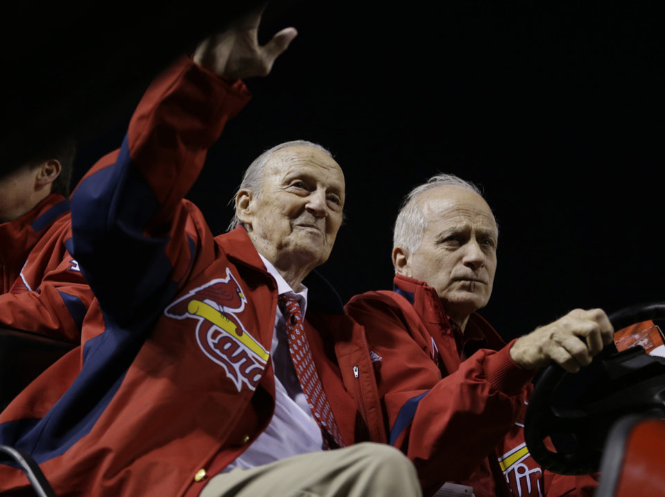 Photo -   Hall of Famer Stan Musial wave as he drives around Busch Stadium before Game 4 of baseball's National League championship series between the San Francisco Giants and the St. Louis Cardinals Thursday, Oct. 18, 2012, in St. Louis. (AP Photo/Jeff Roberson)