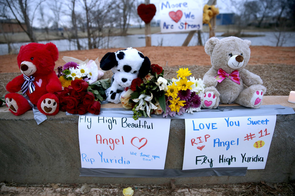 Photo - Memorials in honor of Yuridia Martinez are pictured at the sight of a hit and run incident in Moore at Moore High School in Moore, Okla., Tuesday, Feb. 4, 2020.  [Sarah Phipps/The Oklahoman]