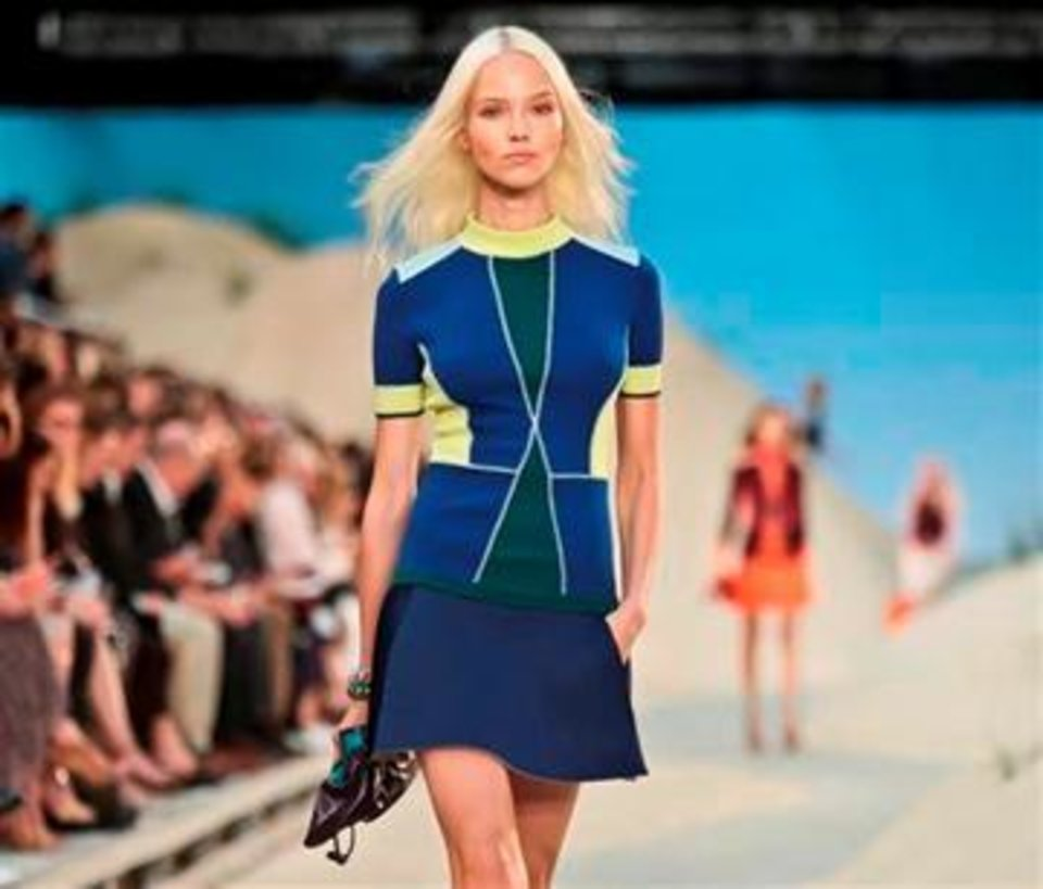 Photo -  An outfit is modeled on the Tommy Hilfiger runway during the spring 2014 fashion show in New York. AP PHOTO.