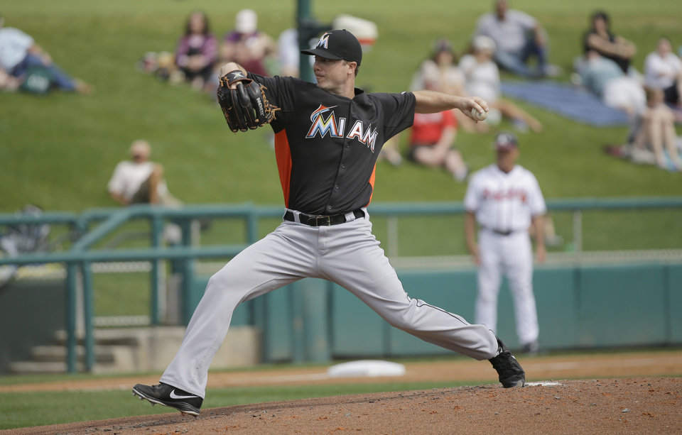 Photo - Miami Marlins pitcher Wade LeBlanc throws during the first inning of an exhibition spring training baseball game against the Atlanta Braves Monday, Feb. 25, 2013, in Kissimmee, Fla. (AP Photo/David J. Phillip)