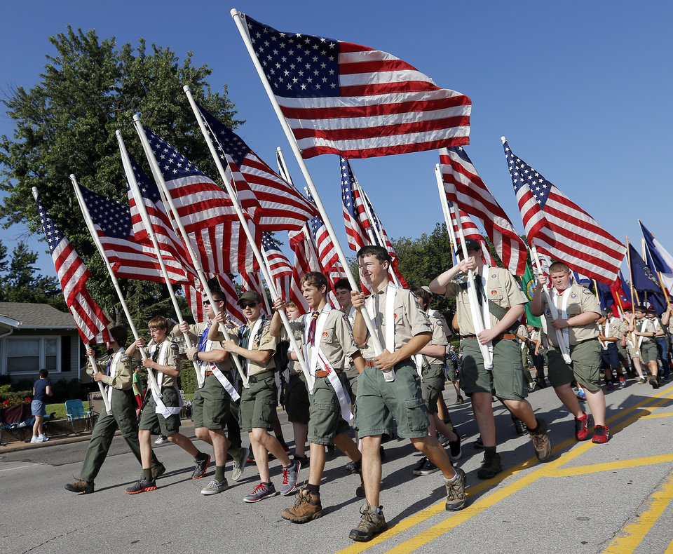 Photo - Boy Scouts carry American flags during the Edmond LibertyFest Parade in downtown Edmond, Okla., on Independence Day, Friday, July 4, 2014. Photo by Nate Billings, The Oklahoman