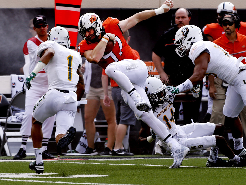 Photo - Oklahoma State's Blake Jarwin (47) runs during the college football game between the Oklahoma State Cowboys (OSU) and the Southeastern Louisiana Lions at Boone Pickens Stadium in Stillwater, Okla., Saturday, Sept. 12, 2015. Photo by Steve Sisney, The Oklahoman