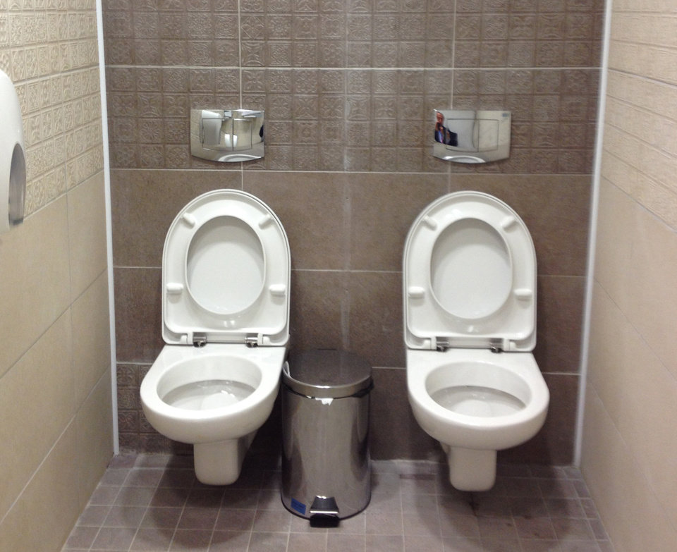 ALTERNATIVE CROP TO LON110 This photo taken on Friday Jan. 17, 2014, shows two toilets at the cross-country skiing and biathlon center for next month�s Olympics in Sochi, Russia. Although two toilets and only one stall like this are not common in Russia, social media users have responded by posting other pictures of toilets standing side by side. One said this was standard at Russian soccer stadiums. (AP Photo/Steve Rosenberg, BBC)