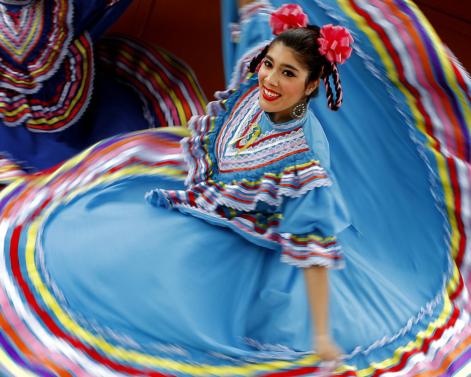 Photo - Angela Barraza, 17, with Everything Goes Dance Studio performs a Mexican Folkloric dance during the annual Plaza District Festival in Oklahoma City, Saturday, Sept. 28, 2013. Photo by Bryan Terry, The Oklahoman