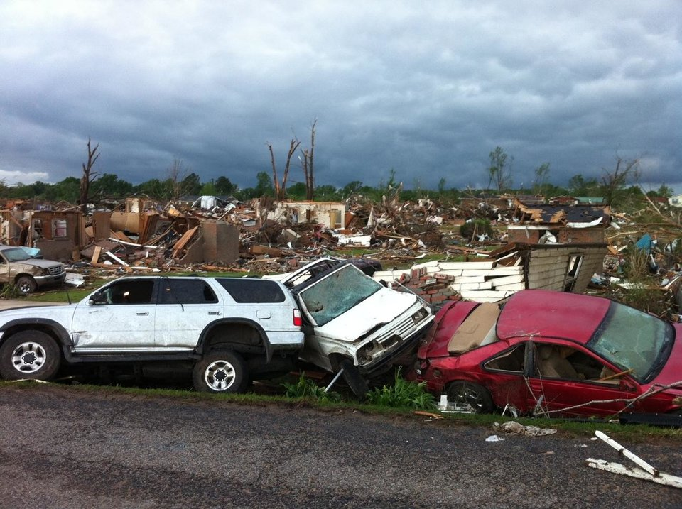 Photo - A tornado has flattened Pleasant Grove, Ala., a subdivision of Mountain Grove, Thursday, April 28. 2011. Dozens of tornadoes spawned by a powerful storm system wiped out entire towns across a wide swath of the South, killing at least 194 people, and officials said Thursday they expect the death toll to rise.  (AP Photo/Greg Bluestein)