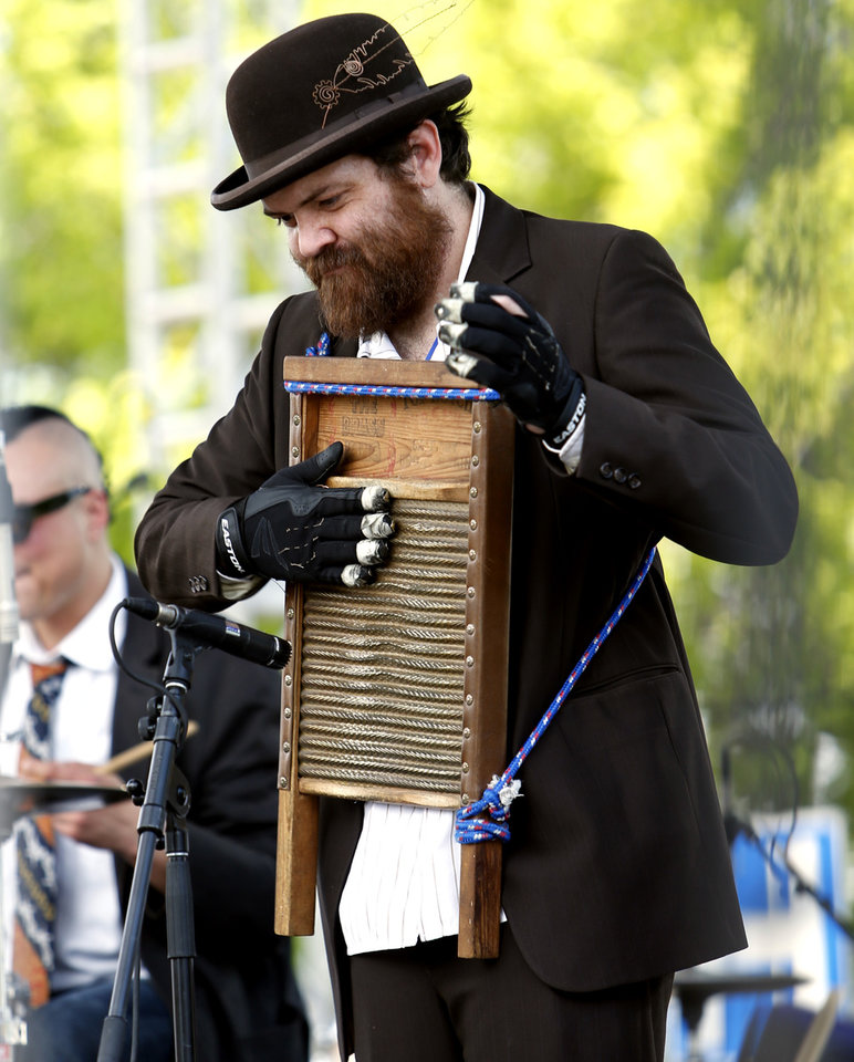 Photo - A member of Caleb McGee's band plays a washboard during the Norman Music Festival on Saturday, April 26, 2014 in Norman, Okla.  Photo by Steve Sisney, The Oklahoman