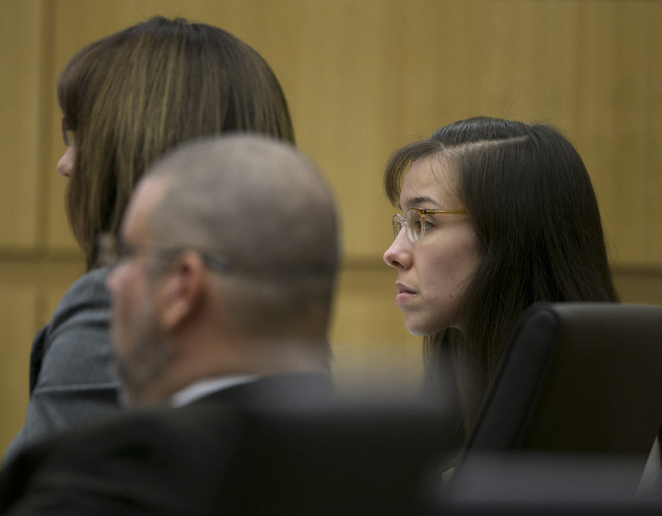Photo - Jodi Arias listens during her trial at Maricopa County Superior Court in Phoenix on Tuesday, April 16, 2013. Defense attorneys rested their case Tuesday after about 2 1/2 months of testimony aimed at portraying Arias as a domestic violence victim who fought for her life the day she killed her one-time boyfriend.  (AP Photo/The Arizona Republic, David Wallace, Pool)