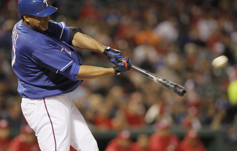 Texas Rangers\' Nelson Cruz (17) hits a home run to center field during the fifth inning of an exhibition baseball game against the Mexico City Red Devils on Thursday, March 28, 2013, in Arlington, Texas. (AP Photo/Fort Worth Star-Telegram, Brandon Wade)