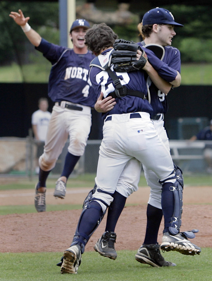 Photo - Edmond North's Zach Barton rushes in to join the hug by catcher Scott Johnson and pitcher Tyler Welch as they celebrate their upset win over Broken Arrow in the 6A State Baseball Championship at Oral Roberts University in Tulsa, OK, May 12, 2012. MICHAEL WYKE/Tulsa World