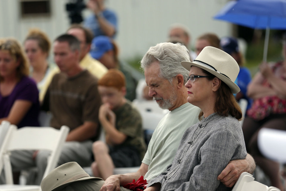 Photo - People attend a memorial on Saturday at the Orr Family Farm, 14400 S Western, for animals who died in recent tornadoes.   SARAH PHIPPS - SARAH PHIPPS
