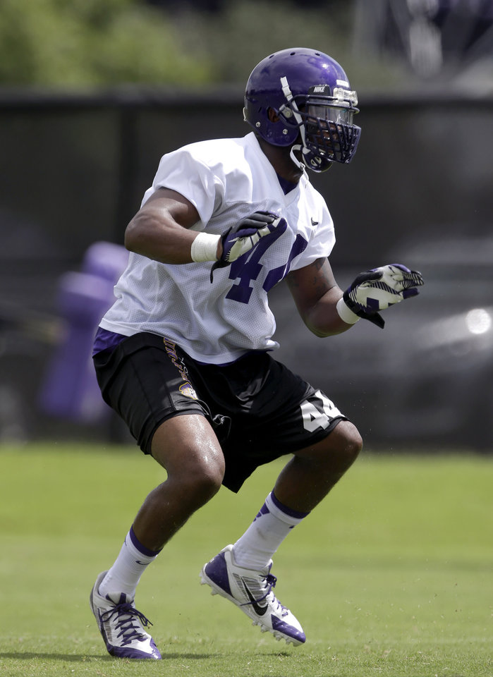 Photo - East Carolina inside linebacker Zeek Bigger participates in a drill during an NCAA college football practice in Greenville, N.C., Tuesday, Aug. 5, 2014. East Carolina finally had a reliable defense to go with its always-explosive offense last year. Now eight defensive starters are gone, meaning the Pirates have to prove they can do enough defensively.  (AP Photo/Gerry Broome)