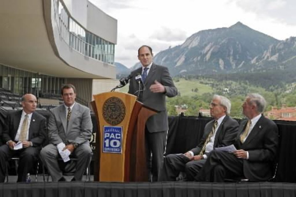 Pac-10 Commissioner Larry Scott, center, welcomes the University of Colorado to the Pac-10 Conference during ceremonies at the University of Colorado in Boulder, Colo., on Friday, June 11, 2010. (AP Photo/Ed Andrieski)