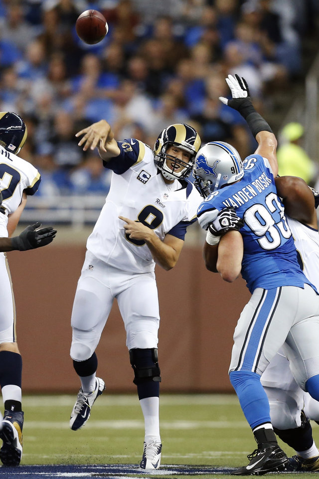 Photo -   St. Louis Rams quarterback Sam Bradford (8) passes the ball as Detroit Lions defensive end Kyle Vanden Bosch (93) rushes in the first quarter of an NFL football game in Detroit, Sunday, Sept. 9, 2012. (AP Photo/Rick Osentoski)