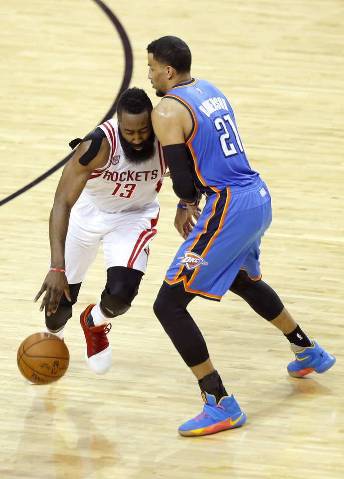 Photo - Oklahoma City's Andre Roberson (21) defends against Houston's James Harden (13) during Game 5 in the first round of the NBA playoffs between the Oklahoma City Thunder and the Houston Rockets in Houston, Texas,  Tuesday, April 25, 2017.  Houston won 105-99. Photo by Sarah Phipps, The Oklahoman