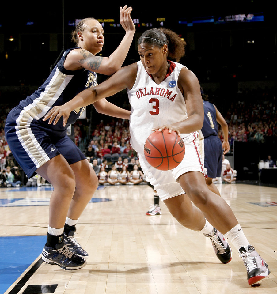 Photo - OU / UNIVERSITY OF OKLAHOMA / NCAA TOURNAMENT / SWEET SIXTEEN / SWEET 16 / SHAWNICE WILSON: OU's Courtney Paris drives past Pittsburgh's Pepper Wilson during the NCAA women's college basketball tournament game between Oklahoma and Pittsburgh at the Ford Center in Oklahoma City, Sunday, March 29, 2009.  PHOTO BY BRYAN TERRY, THE OKLAHOMAN ORG XMIT: KOD