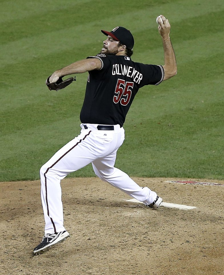 Photo - Arizona Diamondbacks pitcher Josh Collmenter delivers a pitch against the San Diego Padres during the fifth inning of a baseball game, Saturday, May 25, 2013, in Phoenix.  (AP Photo/Matt York)