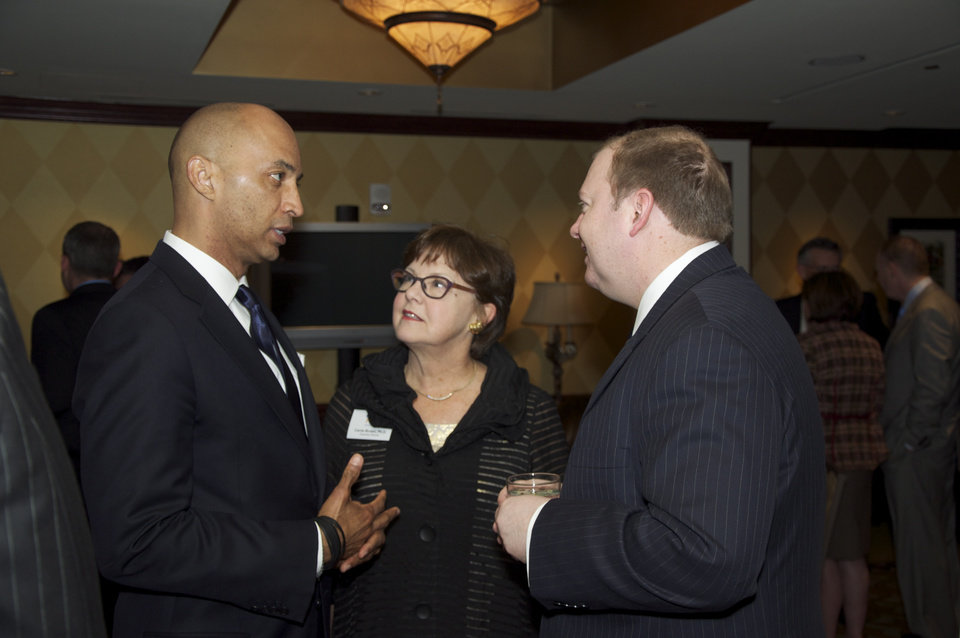 Photo -  Keynote speaker Bryon Pitts, left, talks with Carrie Brown and Frank Sewell IV during the reception. PHOTO BY M. TIM BLAKE, FOR THE OKLAHOMAN