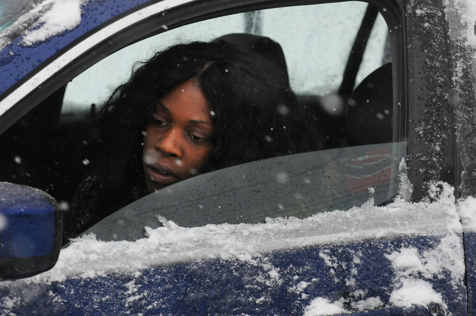 Icey McCoonnell helps her friend free her car from deep snow  that swept through the area on Dec. 6, 2013, in Carbondale, Ill. (AP Photo/The Southern, Steve Matzker)
