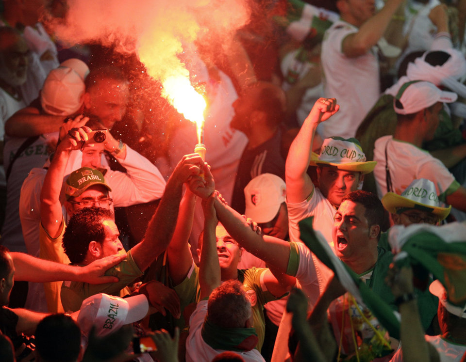 Photo - Algeria fans celebrate after Algeria's Islam Slimani scored his side's first goal during the group H World Cup soccer match between Algeria and Russia at the Arena da Baixada in Curitiba, Brazil, Thursday, June 26, 2014. (AP Photo/Michael Sohn)