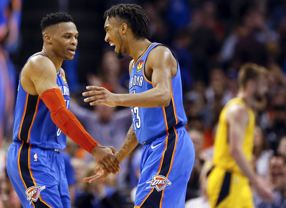 Photo - Oklahoma City's Russell Westbrook (0), left, and Terrance Ferguson (23) celebrate after Westbrook threw a pass to Ferguson for an alley-oop in the fourth quarter during an NBA basketball game between the Indiana Pacers and the Oklahoma City Thunder at Chesapeake Energy Arena in Oklahoma City, Wednesday, March 27, 2019. Oklahoma City won 107-99. Photo by Nate Billings, The Oklahoman