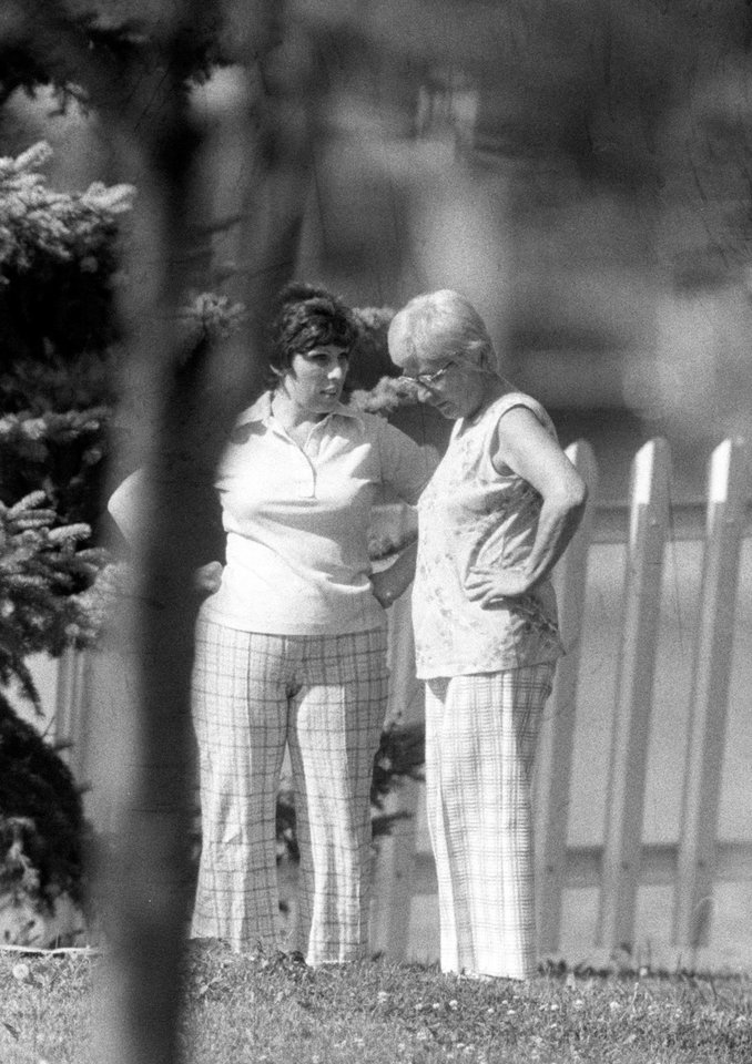 Photo -   FILE - In this Aug. 14, 1975, file photo Josephine Hoffa, right, wife of ex-Teamster president Jimmy Hoffa, and her daughter Barbara Crancer walk behind the family home in Lake Orion, Mich. Crancer, seeking information on her father, filed a Freedom of Information Act lawsuit against the FBI in 1989 demanding the agency's reports on her father's disappearance. (AP Photo, File)