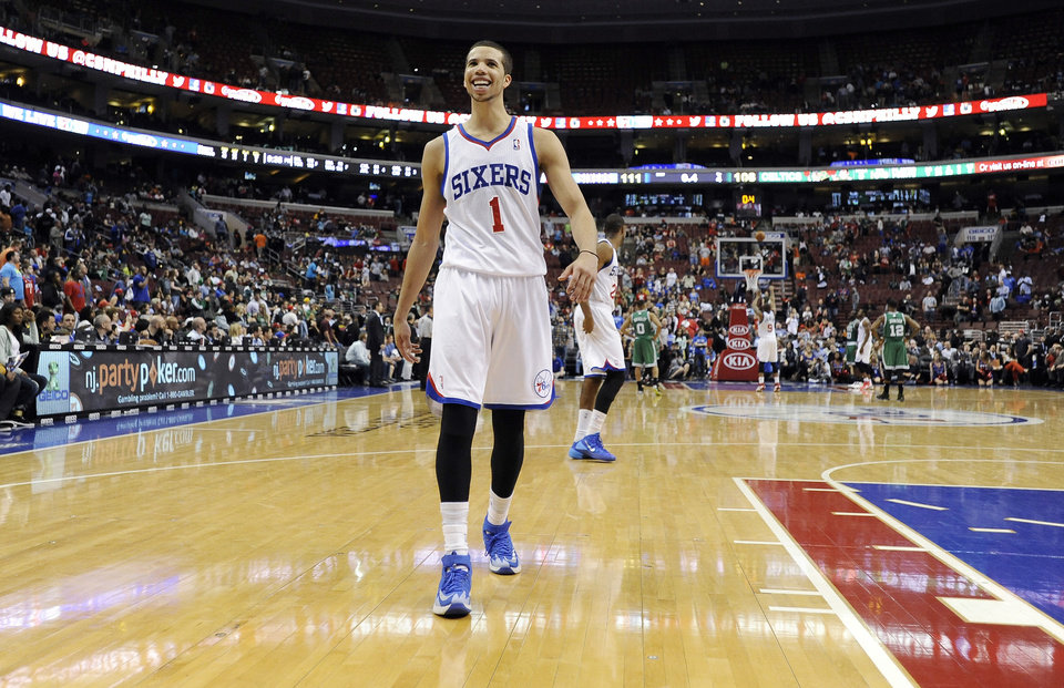 Photo - Philadelphia 76ers' Michael Carter-Williams smiles at the crowd towards the end of the second half of an NBA basketball game on Monday, April 14, 2014, in Philadelphia. The 76ers won 113-108. (AP Photo/Michael Perez)