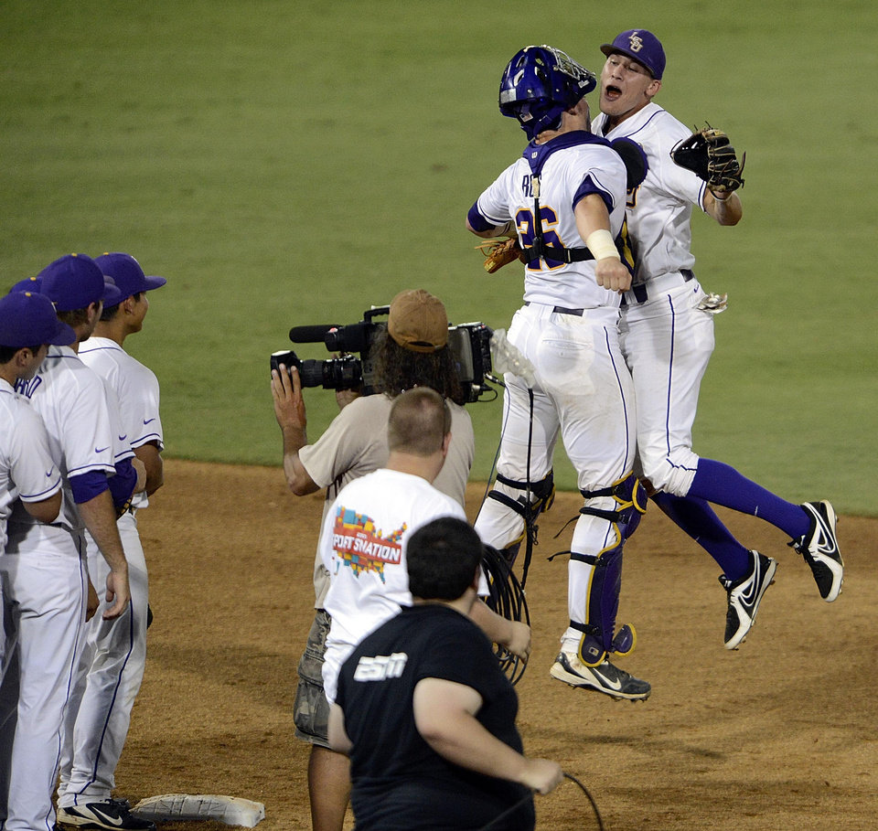 LSU's Ty Ross (26) and JaCoby Jones, right, celebrate after an NCAA college baseball tournament regional game against Oklahoma, Friday, June 7, 2013, in Baton Rouge, La. LSU won 2-0. (AP Photo/Bill Feig) ORG XMIT: LABF103