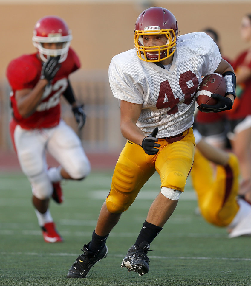 Photo - Putnam City North's Marcus Branker runs during a football scrimmage against Lawton at Putnam City High School in Warr Acres, Okla., Thursday, August 16, 2012. Photo by Bryan Terry, The Oklahoman