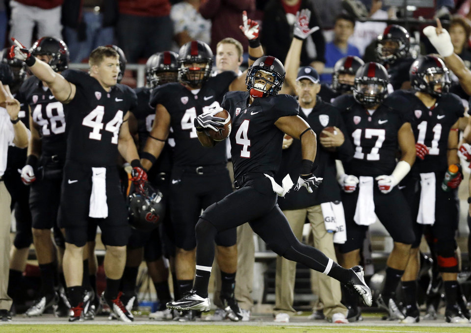 Photo -   Stanford's Drew Terrell runs down the sideline on a 76-yard punt return for a touchdown against Duke during the first half of an NCAA college football game in Stanford, Calif., Saturday, Sept. 8, 2012. (AP Photo/Marcio Jose Sanchez)