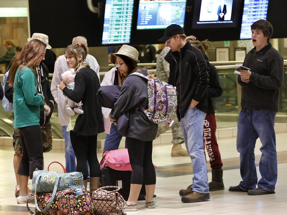 A group of travelers waits for other members of their party to arrive near the American Airlines ticket counter early Thursday morning,  Dec. 20, 2012, inside Will Rogers World Airport.  Photo by Jim Beckel, The Oklahoman