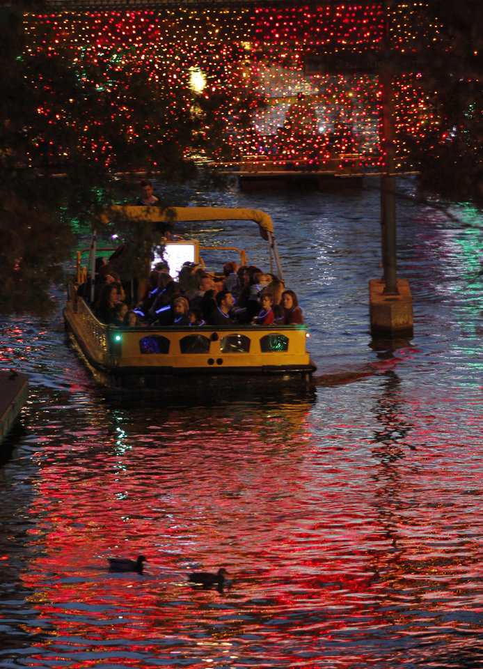 CHRISTMAS / HOLIDAYS / WATER TAXI: People enjoy the free canal boat rides under the holiday lights during the OneMain Financial Lights the Bricktown Canal event, which is part of Downtown in December in Oklahoma City Saturday, November 19, 2011. Photo by Doug Hoke, The Oklahoman