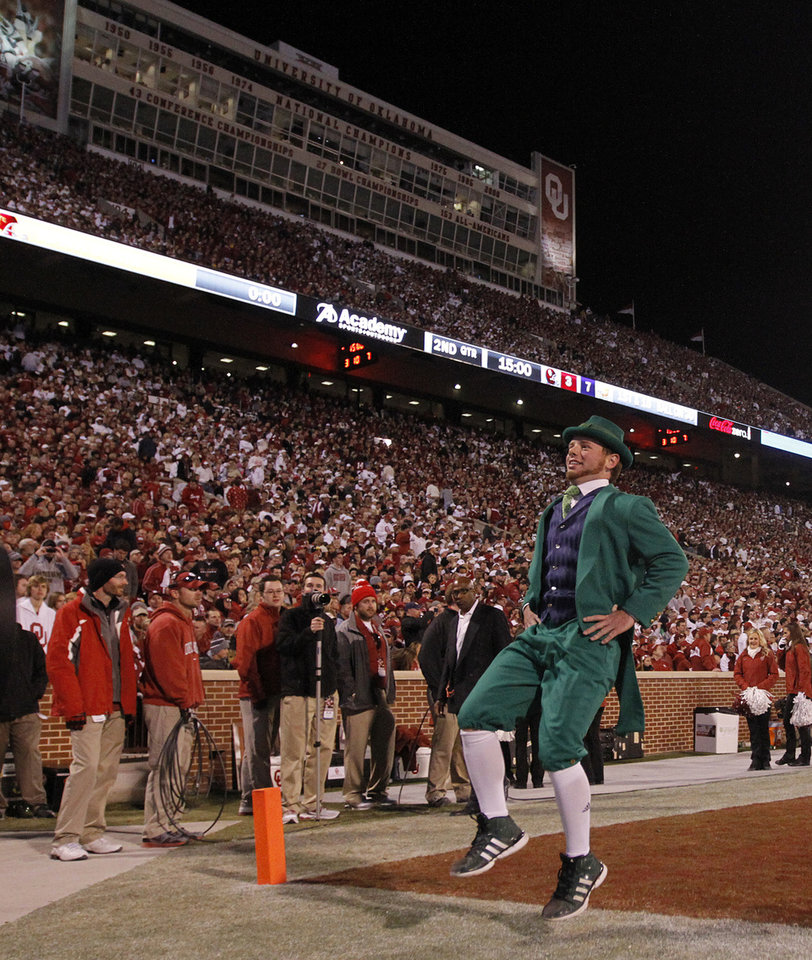 Photo - The Notre Dame mascot celebrates a touchdown during the college football game between the University of Oklahoma Sooners (OU) and the Notre Dame Fighting Irish at the Gaylord Family-Oklahoma Memorial Stadium on Saturday, Oct. 27, 2012, in Norman, Okla. Photo by Chris Landsberger, The Oklahoman