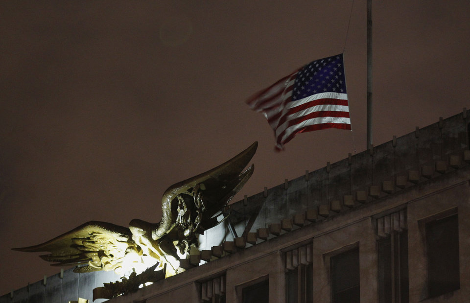 Photo - The U.S. flag flies at half staff at the U.S. Embassy in London in reaction to the shootings at Sandy Hook Elementary School in Connecticut, Saturday, Dec. 15, 2012. (AP Photo / Sang Tan) ORG XMIT: LST132