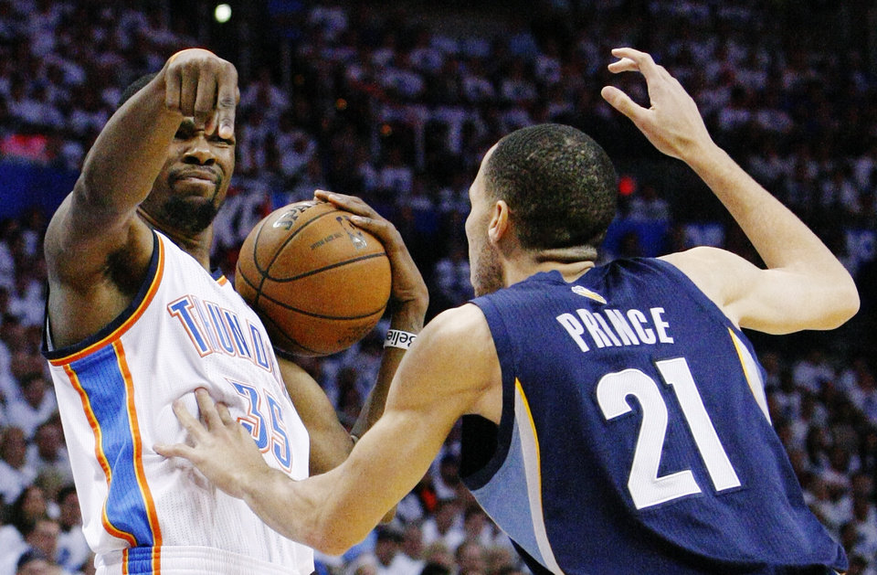 Photo - Oklahoma City Thunder forward Kevin Durant (35) signals as Memphis Grizzlies forward Tayshaun Prince (21) defends during the first half of Game 5 of a Western Conference semifinal in the NBA basketball playoffs, in Oklahoma City, Wednesday, May 15, 2013. (AP Photo/Alonzo Adams)