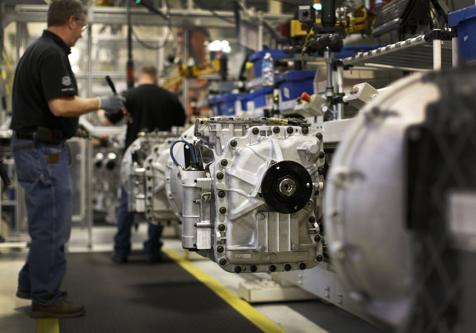 Photo - In this March 26, 2014 photo, workers build automated manual transmissions at Volvo Trucks' powertrain manufacturing facility in Hagerstown, Md. The Labor Department releases first-quarter productivity data on Wednesday, May 7, 2014. (AP Photo/Patrick Semansky)