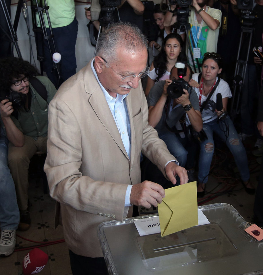 Photo - Ekmeleddin Ihsanoglu, the main opposition candidate in the presidential election, casts his vote at a polling station in Istanbul, Turkey, on Sunday, Aug. 10, 2014. Turks were voting in their first direct presidential election Sunday - a watershed event in Turkey's 91-year history, where the president was previously elected by Parliament. Prime Minister Recep Tayyip Erdogan, who has dominated the country's politics for the past decade, is the strong front-runner to replace the incumbent, Abdullah Gul, for a five-year term. (AP Photo/Emrah Gurel)
