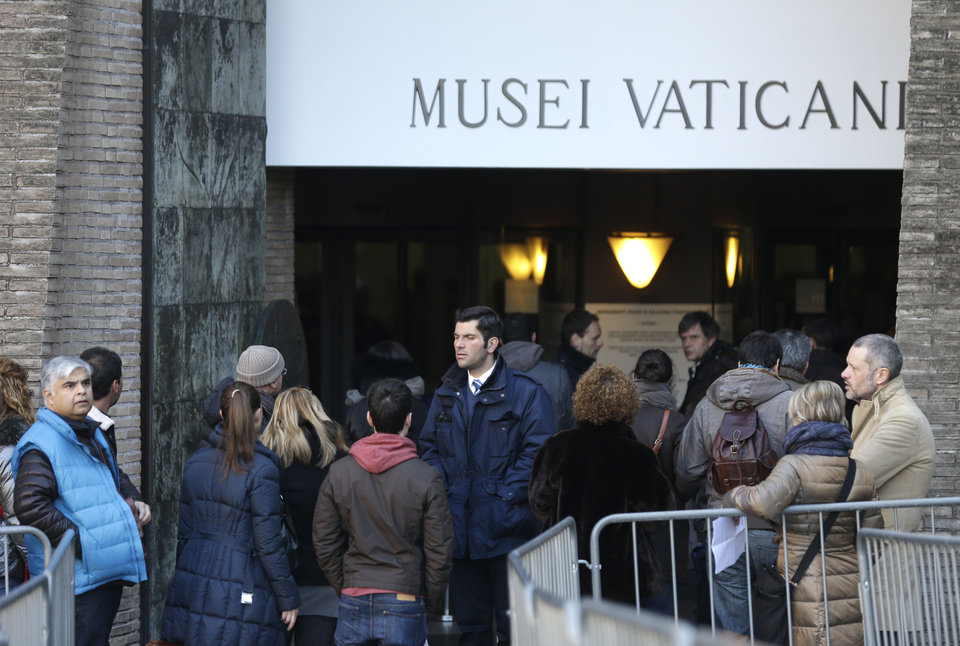 Photo - People queue to enter the Vatican Museums, at the Vatican Thursday, Jan. 3, 2013. It's