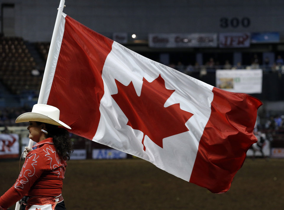 The Canadian cowgirls perform during  the International Finals Rodeo at the State Fair Arena in Oklahoma City,  Saturday, January 19, 2013. Photo by Sarah Phipps, The Oklahoman