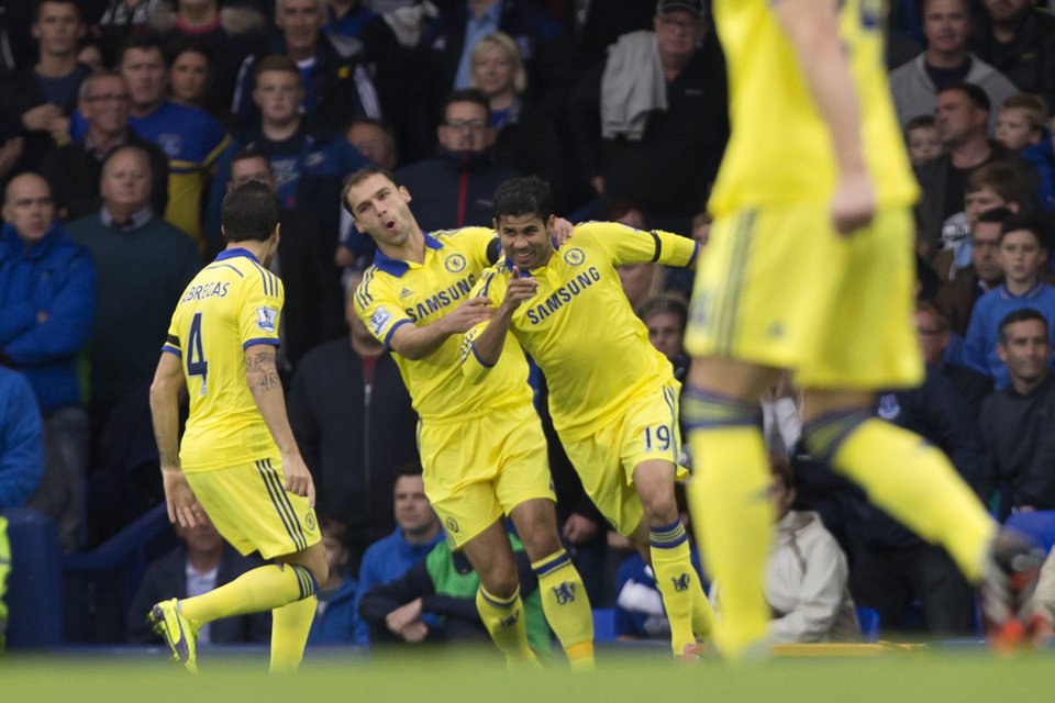 Photo - Chelsea's Diefo Costa, centre right, celebrates with teammates after scoring against Everton during their English Premier League soccer match at Goodison Park Stadium, Liverpool, England, Saturday Aug. 30, 2014. (AP Photo/Jon Super)