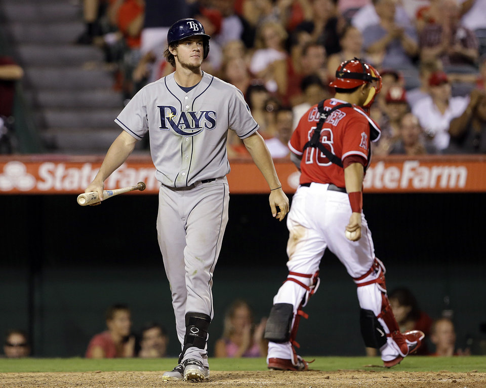 Photo - Tampa Bay Rays' Will Myers strikes out with the bases loaded as Los Angeles Angels catcher Hank Conger heads for the dugout in the fifth inning of a baseball game in Anaheim, Calif., Monday, Sept. 2, 2013. (AP Photo/Reed Saxon)