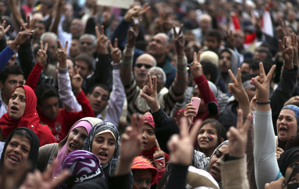Egyptian protesters chant slogans as they attend a demonstration against a constitution drafted by Islamist supporters of President Mohammed Morsi in Tahrir square in Cairo, Egypt, Friday, Dec. 14, 2012. Opposing sides in Egypt's political crisis were staging rival rallies on Friday, the final day before voting starts on a contentious draft constitution that has plunged the country into turmoil and deeply divided the nation.(AP Photo/Khalil Hamra)