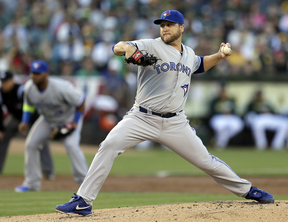 Photo - Toronto Blue Jays' Mark Buehrle works against the Oakland Athletics in the first inning of a baseball game on Saturday, July 5, 2014, in Oakland, Calif. (AP Photo/Ben Margot)