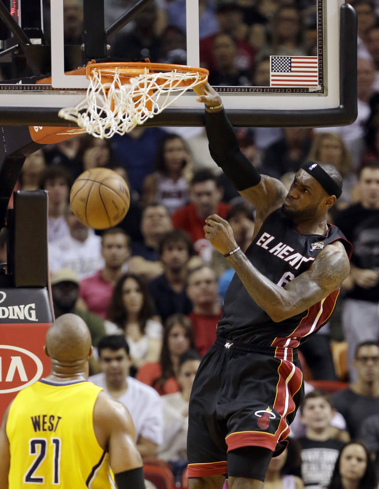 Photo - Miami Heat's LeBron James (6) dunks against the Indiana Pacers during the first half of an NBA basketball game in Miami, Sunday, March 10, 2013. (AP Photo/Alan Diaz)